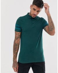 c4378774 ASOS - Organic Skinny Polo Shirt With Stretch And Contrast Sleeve Stripe In  Green - Lyst