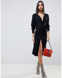 2c6ce177494 ASOS - Relaxed Long Sleeve Midi Dress With Knot Front - Lyst