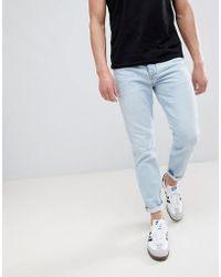River Island - Tapered Jeans In Light Wash Blue - Lyst