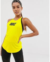 fc70459f42 Nike Training Loose Breathe Tank In White in White - Lyst