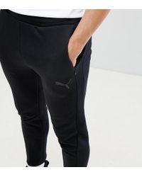 PUMA - Pantalones de chándal Evostripe Move - Lyst