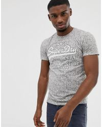 Superdry - All Over Logo Printed T-shirt In White - Lyst