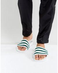 adidas Originals - Adilette Slides In White Bb0124 - Lyst