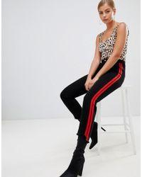 Boohoo - Contrast Side Tape Raw Hem Jeans In Black - Lyst