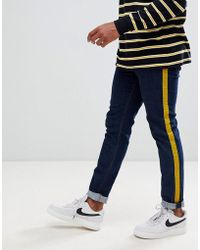 49ab0095150a ASOS - Skinny Jeans In Rinse Wash With Mustard Velour Side Stripe - Lyst