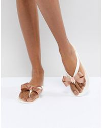 f969784584484 Lyst - Ted Baker Hatha White Bow Flip Flops in White