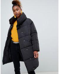 Monki - Longline Puffer Jacket - Lyst