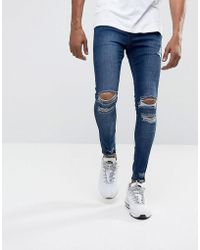 Illusive London - Super Skinny Jeans In Mid Wash Blue With Distressing - Lyst