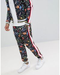 Jaded London - Printed Floral Skinny Joggers With Side Stripes - Lyst