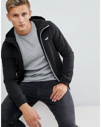 Hollister - Lightweight Hooded Jacket Seagull Logo In Black - Lyst