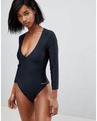 Calvin Klein - Long Sleeved One Piece Swimsuit - Lyst