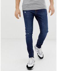 376dd363a341c Bershka - Join Life - Jean super skinny avec déchirures aux genoux et  abrasions - Bleu