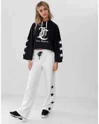Juicy Couture - Juicy By Star Print Wide Leg Trousers - Lyst