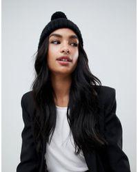 19db586741f Missguided Black Pom Pom Beanie Hat in Black - Lyst