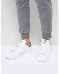 0a2bbcf82485 adidas Originals Stan Smith Leather Sneakers In White And Green