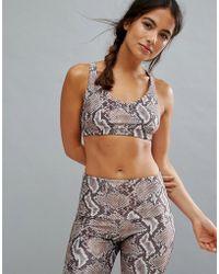 Onzie - Snake Print Weave Yoga Bra - Lyst