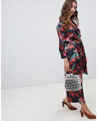 bb1e4007354 Hot Lost Ink - Wide Leg Jumpsuit With Tie Waist In Abstract Floral Print -  Lyst