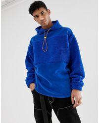 ASOS Oversized-Kapuzenpullover mit Teddyfell und Blockfarben aus Fleece sowie Neonbesatz in Blau