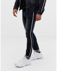 Liquor N Poker - Skinny Jeans With Metalic Sport Stripe In Black - Lyst