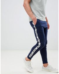 Hollister - Side Tape Logo Track Trousers In Navy - Lyst