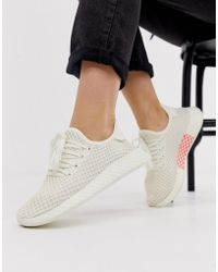 27e5ea337 adidas Originals Deerupt Sneakers In Yellow And Lilac in Yellow - Lyst