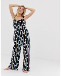 e2167eb2fb1 Lyst - ASOS Star Embellished Jumpsuit With Wide Leg in Black
