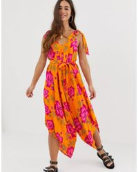 017ac4c69ea ASOS - Tie Shoulder Harem Beach Jumpsuit In Bold Floral Print - Lyst