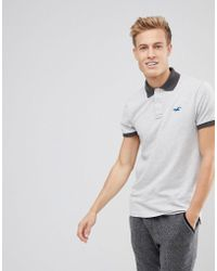 Hollister - Stretch Pique Polo Seagull Logo In Light Grey - Lyst