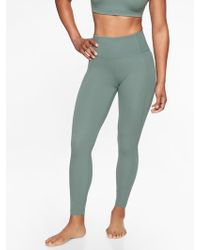 6192c5b30cf06 Athleta Mesh Shine Salutation 7/8 Tight in Blue - Lyst