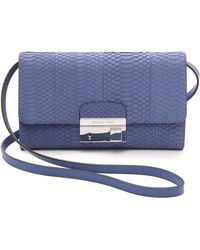 Michael Kors Collection Gia Snakeskin Clutch with Lock - Lyst