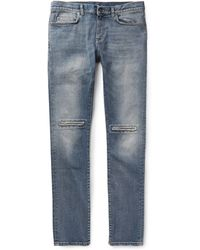 Saint Laurent Slim-Fit 15.5Cm Hem Ripped Denim Jeans - Lyst