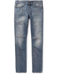 Saint Laurent Slim-Fit Ripped Denim Jeans - Lyst