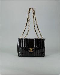 Chanel Preowned Black Patent Leather Vertical Quilt Maxi Flap Bag - Lyst