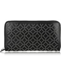 Alaïa Studded Leather Wallet - Lyst