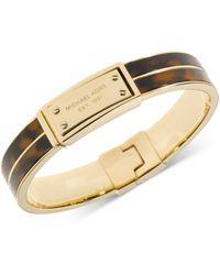 Michael Kors Gold-Tone Tortoise Logo Plate Hinged Bracelet - Lyst