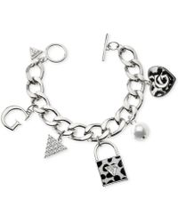 Guess Rhodium-tone Dalmatian Print Multi-charm Toggle Bracelet - Lyst