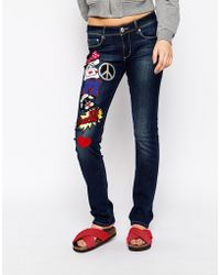 Love Moschino Patch Logo Skinny Jeans - Lyst