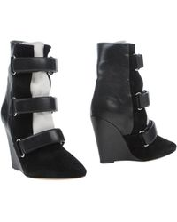 Isabel Marant Rob Leather And Fur Ankle Boots black - Lyst