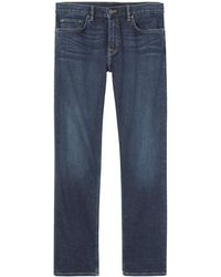 Banana Republic - Straight Rapid Movement Denim Medium Wash Jean - Lyst