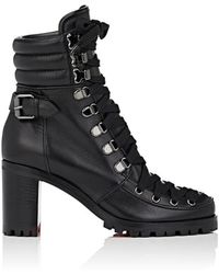 1fb0ddabbf7 Lyst - Christian Louboutin Praguoise Spiked Leather Bootie in Black
