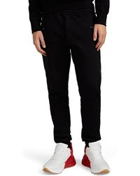 Alexander McQueen - Leather-trimmed Cotton Fleece Jogger Pants - Lyst