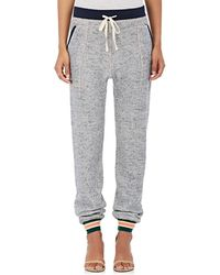 Warm - Topstitched Mélange Cotton Joggers - Lyst
