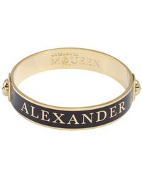 Alexander McQueen Black and Gold Enamel Logo Skull Bangle - Lyst