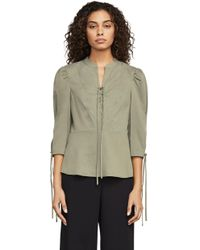BCBGMAXAZRIA - Bcbg Carli Lace-up Peplum Top - Lyst
