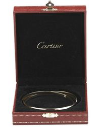 Cartier Pre-owned 18k Rose Yellow and White Gold Rolling Bangle - Lyst