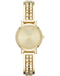 DKNY Women'S Soho Gold-Tone Stainless Steel Bangle Bracelet Watch 24Mm Ny2278 - Lyst