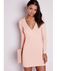 Missguided Long Sleeve Wrap Bodycon Dress Nude pink - Lyst