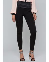 Bebe - Button Corset Leggings - Lyst