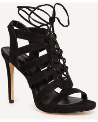 Bebe - Bethh Lace Up Booties - Lyst