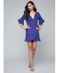 e545c8fdb0 Bebe Satin Deep V-neck Dress in Blue - Lyst